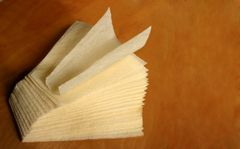9 x 9 x 3.5 inch textured tamale parchment wrap (corn husk substitute); a triangular 9-inch sheet, corn-yellow, case of 1,000