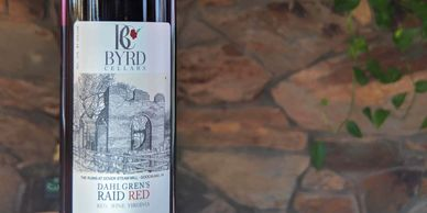 bottle of Byrd Cellars dahlgren's raid red with stone wall background