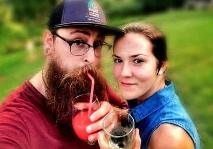 Man and woman drinking Byrd Cellars Wine and Wine Slushie