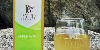 bottle of Byrd Cellars apple wine with glass