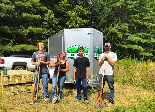 4 people stand with tools by SVT Tool trailer