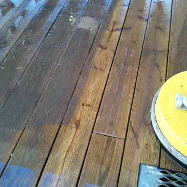 Wood deck pressure wash. Notice the difference.