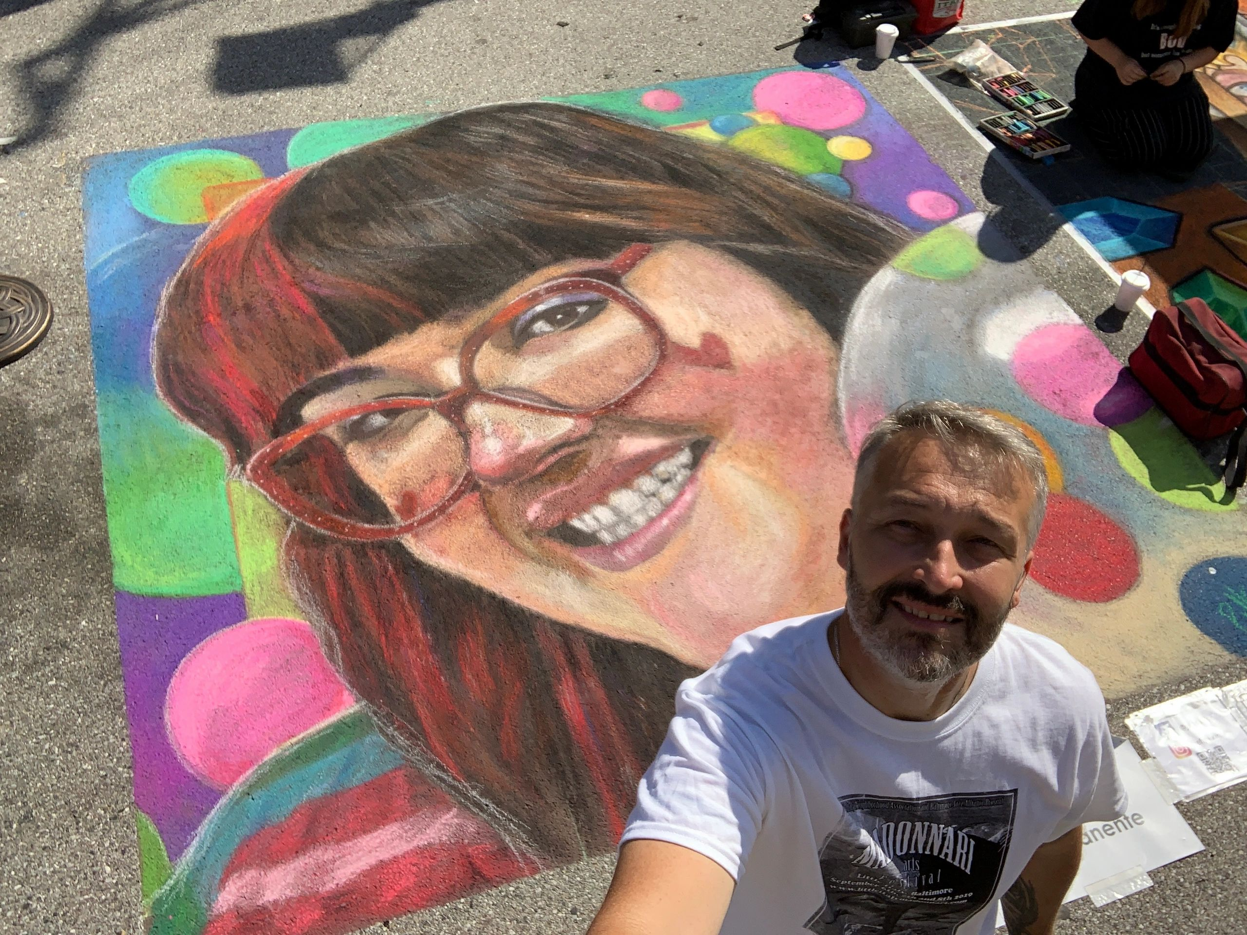 This photo was taken at Little Italy Baltimore Madonnnari Arts Festival 2019.  Its my daughter.