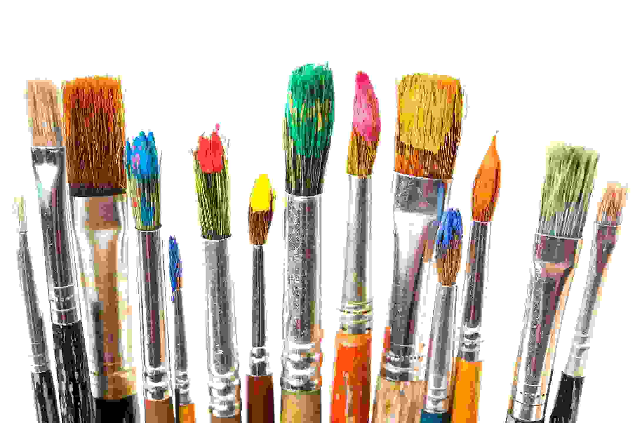 Paintbrushes covered in paint.