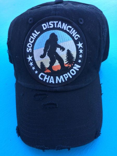 "Hat with, ""SOCIAL DISTANCING CHAMPION,"" embroidered patch"