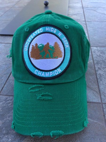 "Hat with, ""UNDEFEATED HIDE AND SEEK CHAMPION,"" embroidered patch"