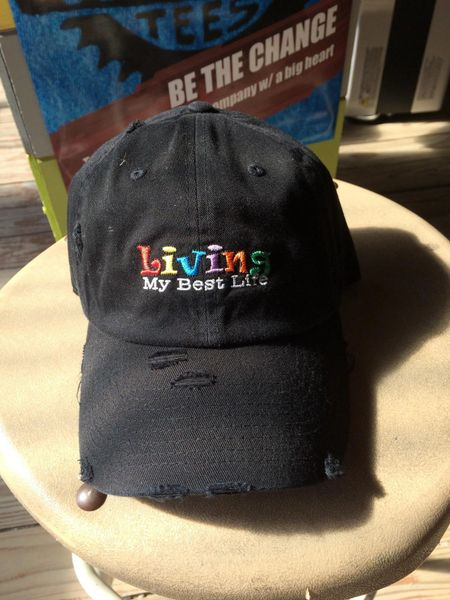 "Hat with, ""LIVING MY BEST LIFE,"" embroidered stitch"