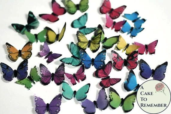 48 small rainbow edible butterflies for cake decorating.