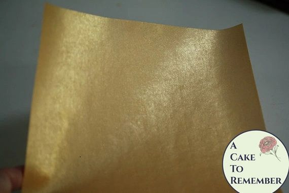 Three sheets printed gold edible wafer paper for cake decorating.