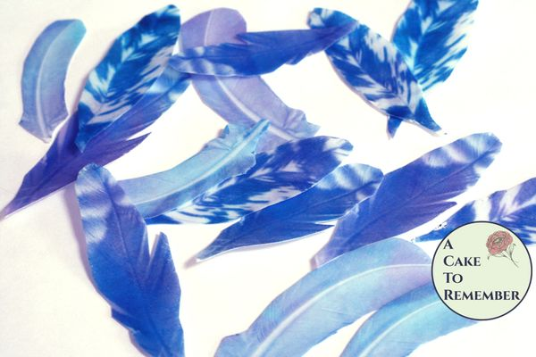 """15 large 3.5-4"""" wafer paper feathers, shades of blue. Edible feathers for a unique wedding or birthday cake topper"""