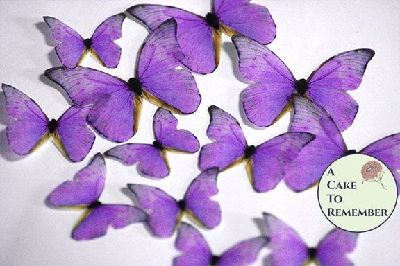 12 lavender wafer paper edible butterflies for wedding cake toppers.