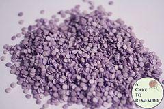 Tiny lavender purple sequins edible confetti cupcake sprinkles.