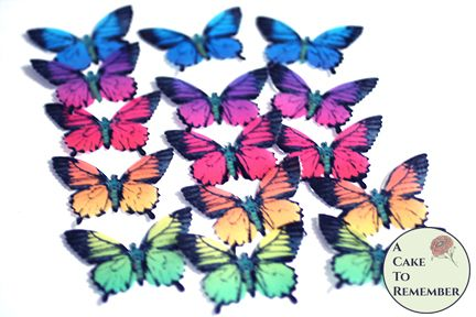 "15 bright rainbow wafer paper cupcake topper edible butterflies. 2"" wide."