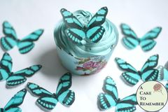 "15 2"" wide teal blue wafer paper edible butterfly cupcake toppers"