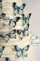 "15 2"" wide pale blue and white wafer paper edible butterfly cupcake toppers"