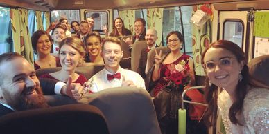 Wedding guests being transported onboard The Avocado Bus in Perth