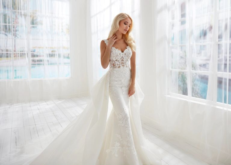 Bride wearing a wedding gown by Randy Fenoli found at Bridal Boutique