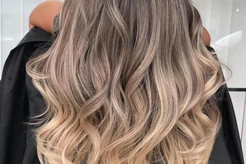 women with a ash balayage ombre done in a salon in west palm beach