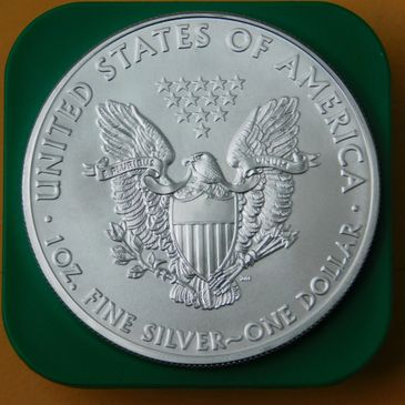 1 oz silver bullion silver eagle bu .999 fine silver reverse side from a gem bu condition silver eagle roll on top of the government green cap from the top of the roll