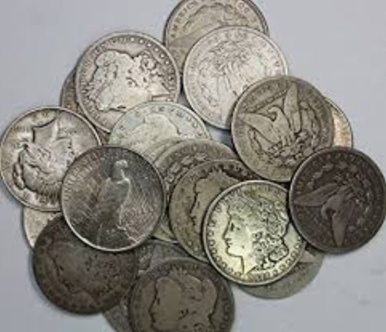 coin collection of morgan silver dollars and peace silver dollars circulated used silver dollars