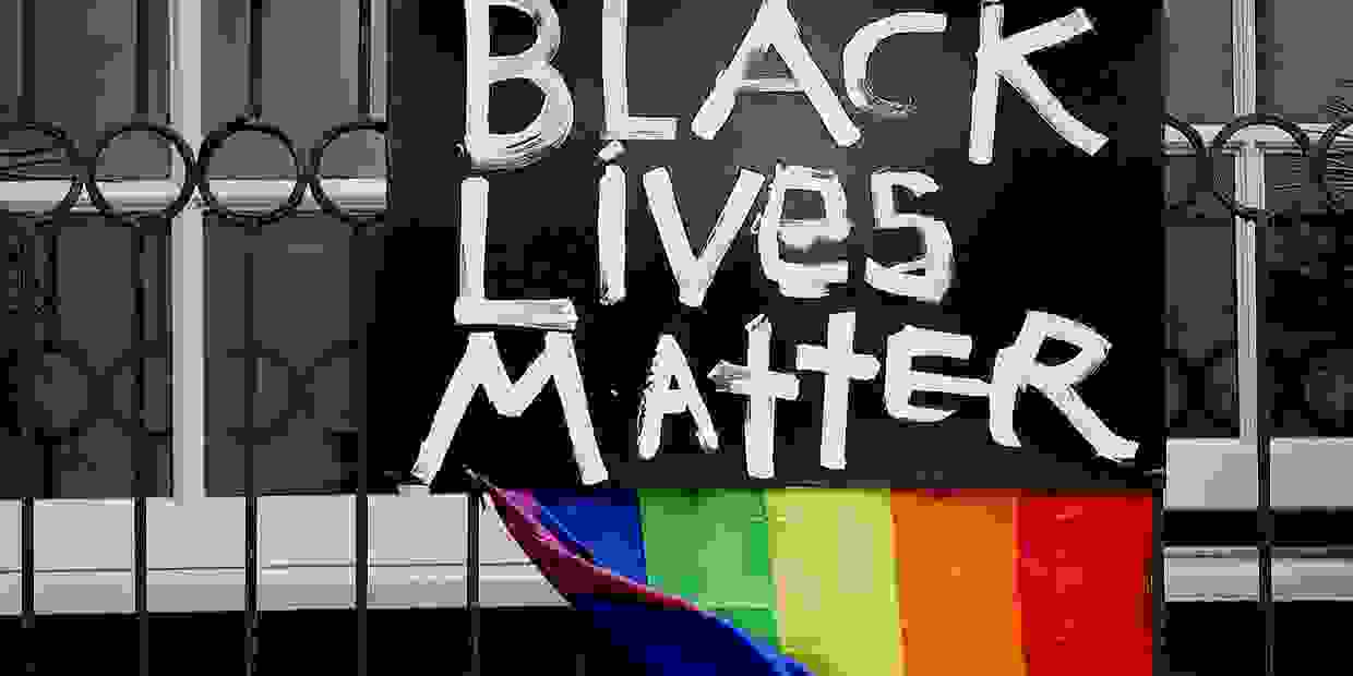 Black Lives Matter and rainbow banner hang from a San Francisco window following the death of George