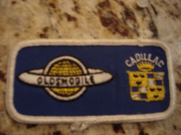 OLDS & CADILLAC SERVICE BADGE