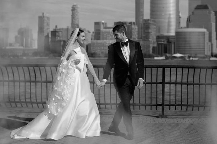 BRIDE AND GROOM ON THEIR WEDDING DAY,  WITH NEW YORK CITY AS THEIR BACKDROP.