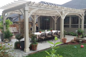 outdoor pergola sitting area. Custom built wood structure