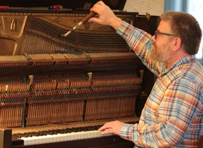 Joe Kemple tuning upright piano