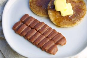 Shaped purée bacon strips with shaped purée bread pancakes. IDDSI safe texture.