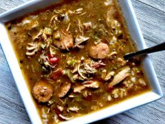 """Previous Item: """"Fat Tuesday,"""": Choice of: Andouille & Chicken, Stuffed Quail, or Seafood 1) Gumbo, or 2) Jambalaya"""