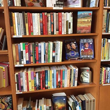 Friends Used Bookstore shelf in the Lindley Perk Coffee Shop at the Bozeman Public Library