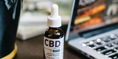 CBD oil Drops on desk Dr Ganja CBD Oil Hemp oil Full spectrum