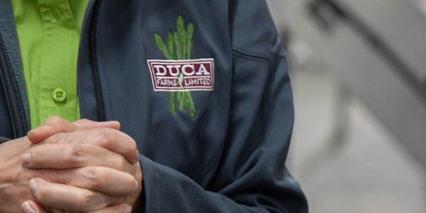 Erica Van Es's Duca Farms branded jacket on our first scout trip to the farm.