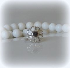 FLOWER WITH GARNET RING