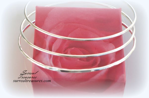 A SINGLE STERLING SILVER BANGLE