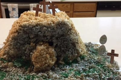 Calvary Hill presented as a chocolate cake with tan coconut as dirt & green coconut as grass.