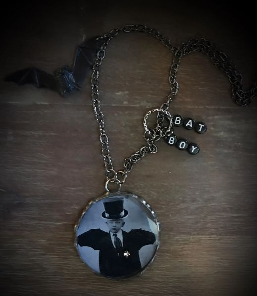 Small bat boy necklace