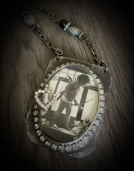 Vintage image cherub necklace in resin