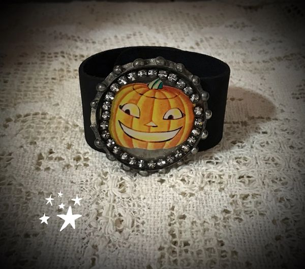 Leather cuff with rhinestones and pumpkin