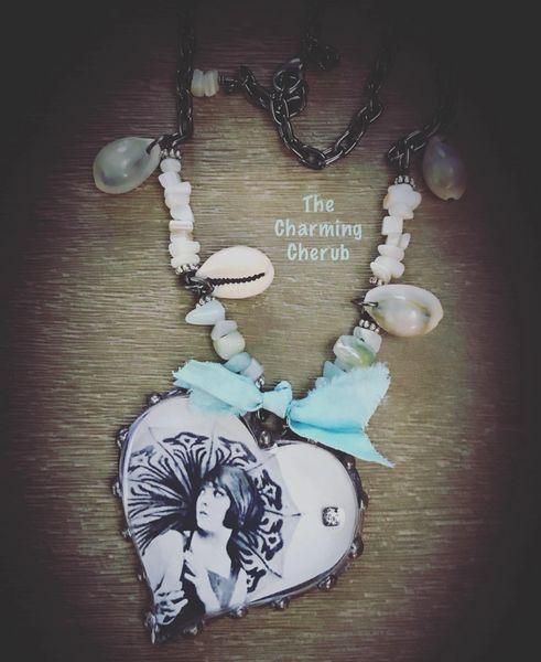 Heart shape bathing beauty and shells