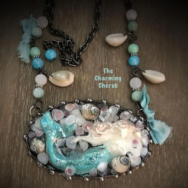 Sculpted mermaid necklace and shells