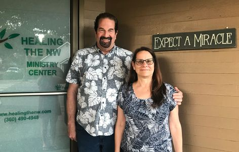 Marc & Lydia Buchheit in front of the healing the northwest office