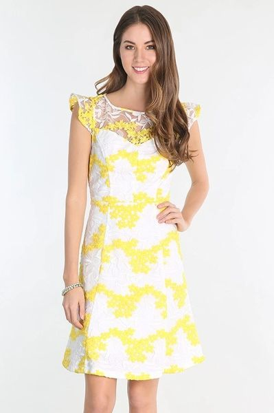 Barefoot in Daisy's Embroidered Ivory and Yellow Dress