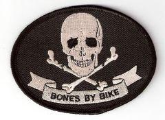 BONES BY BIKE WITH SKULL AND BROKEN BONES