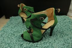 Worn, pre-owned Sexy Green High Heel Shoes with Black buckles and straps.