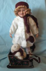 "COLLECTIBLE DOLLS: Porcelain 16"" Wintry Dressed Doll with Sled & Polar Bear"
