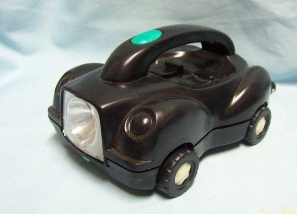 "FLASHLIGHT: Cute Clever Car-shaped 16 piece Tool Set and Flashlight 8 3/4"" x 4"" tall"