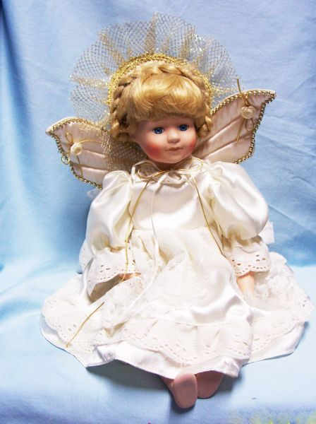 "COLLECTIBLE DOLLS: Collectible Porcelain 17"" Sitting Angel Doll with Quilted Ivory Wings"