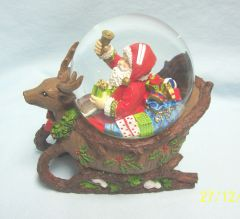 CHRISTMAS SANTA SNOWGLOBE: Santa and his Bag of Gifts Snow Globe Riding in Unique Reindeer Shape Sleigh